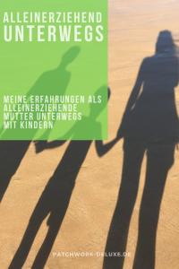 Alleinerziehende Mutter unterwegs mit Kindern